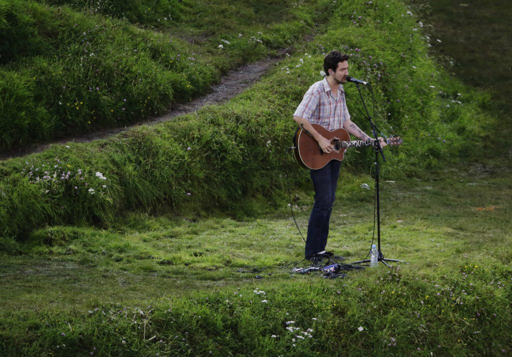 Frank Turner sings during the Opening Ceremony at the 2012 Summer Olympics, Friday, July 27, 2012, in London. (AP Photo/Charlie Riedel)