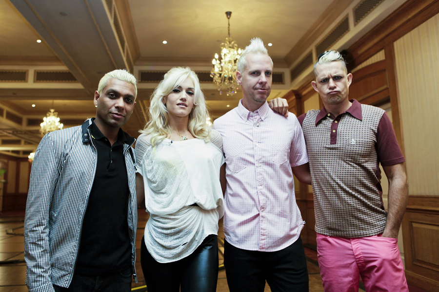 American rock band, No Doubt, pose during a film shoot for the F1 Rocks TV program, on Thursday, Sept. 24, 2009, in Singapore. The band is in the city-state to perform at F1 Rocks, a three-day concert running from Thursday to Saturday, Sept. 26. From left to right are: bass player Tony Kanal, lead singer Gwen Stefani, guitarist Tom Dumont, and drummer Adrian Young. (AP Photo/Joan Leong)