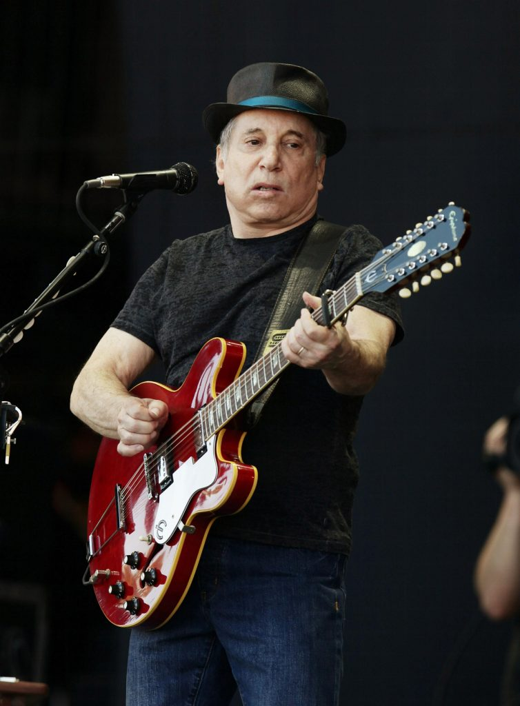 Paul Simon performing on the Pyramid Stage, at the Glastonbury Music Festival held at Worthy Farm, Pilton.
