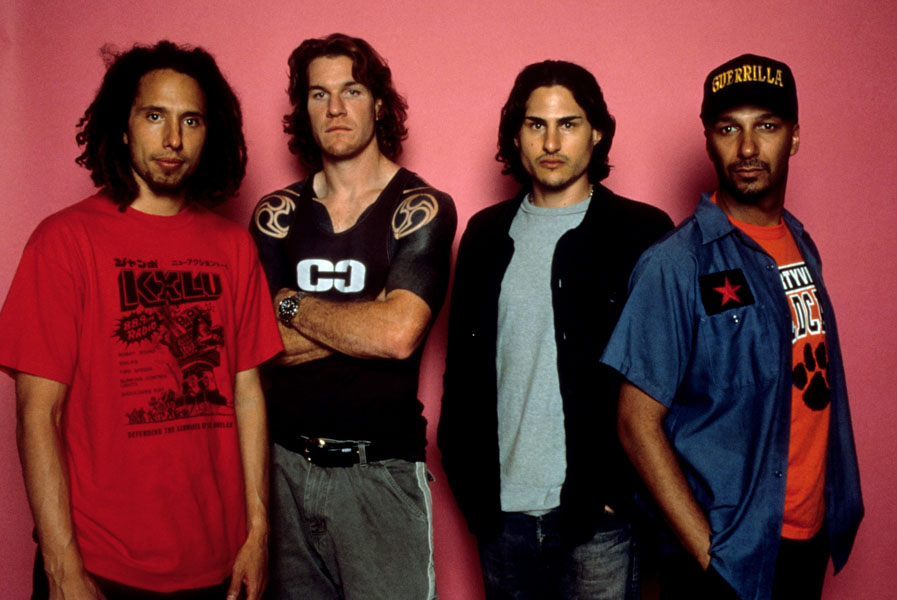 American rock band Rage Against the Machine pose for the camera in the studio. (L-R) Zack de la Rocha, Tim Commerford, Brad Wilk and Tom Morello.