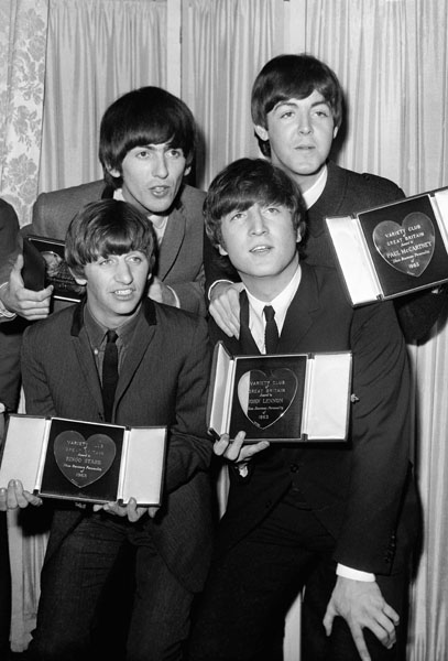 The Beatles with their Variety Club award for Showbiz personalities of the Year (1963). The Awards were held at the Dorchester Hotel, London