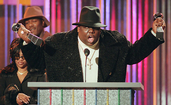 ** FILE **Notorious B.I.G., aka Biggie Smalls, and whose real name is Christopher Wallace, clutches his awards at the podium during the Billboard Music Awards in New York, in this Dec. 6, 1995, file photo. On Tuesday June 21, 2005, jury selection began in Los Angeles in a federal wrongful death lawsuit filed by the New York rapper's family. The lawsuit accuses the Los Angeles Police Department of covering up a former officer's alleged involvement in his March 1997 murder. (AP Photo/Mark Lennihan,file)