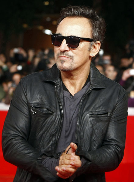 "U.S. rock artist Bruce Springsteen walks on the red carpet to attend the screening of the movie ""The Promise: The Making of Darkness on the Edge of Town"" at the Rome Film Festival at Rome's Auditorium, Monday, Nov. 1, 2010. (AP Photo/Pier Paolo Cito)"