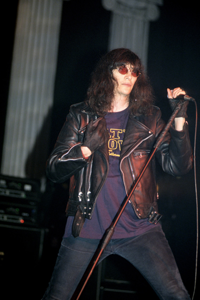 Joey Ramone, vocalist of American punk rock band The Ramones, during their performance live on stage at Brixton Academy in London.