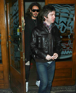 Russell Brand and Noel Gallagher (Right) are spotted leaving The Groucho Club in central London.