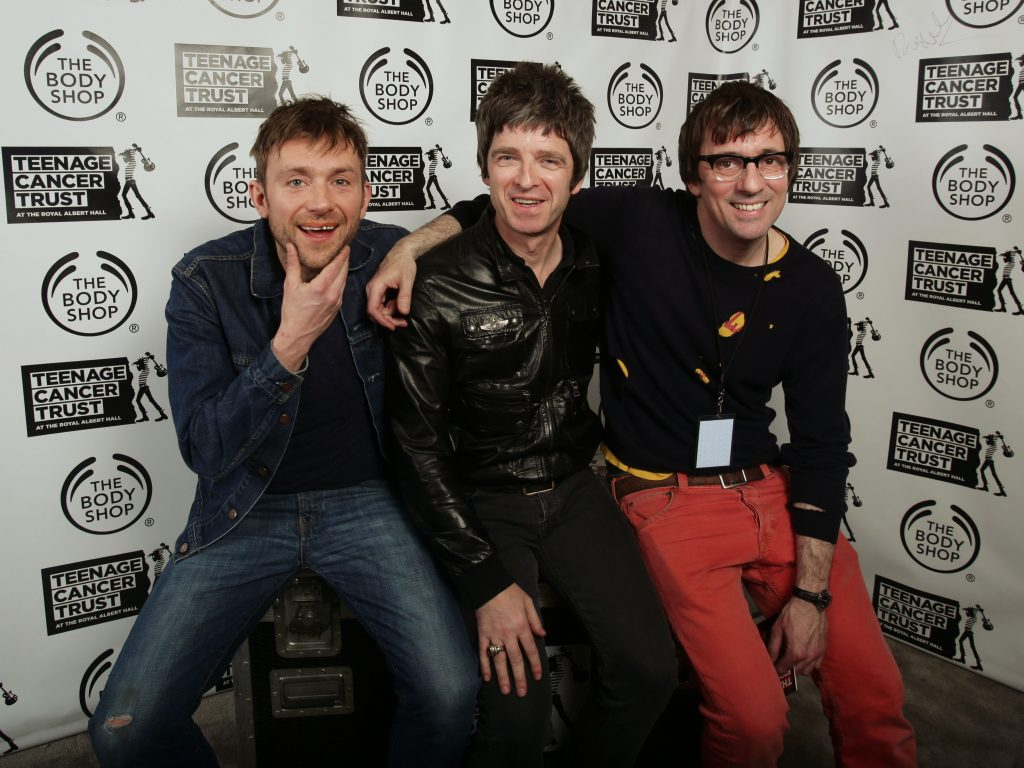 (left to right) Damon Albarn, Noel Gallagher and Graham Coxon backstage during their Teenage Cancer Trust gig, at the Royal Albert Hall in London. PRESS ASSOCIATION Photo. Picture date: Saturday March 23, 2013. Photo credit should read: Yui Mok/PA Wire