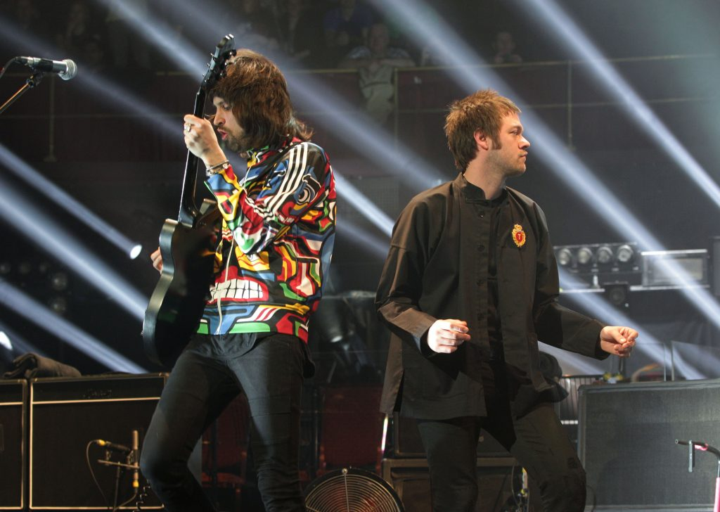 Sergio Pizzorno (left) and Tom Meighan of Kasabian performing on stage during their Teenage Cancer Trust gig, at the Royal Albert Hall in London. PRESS ASSOCIATION Photo. Picture date: Friday March 22, 2013. Photo credit should read: Yui Mok/PA Wire