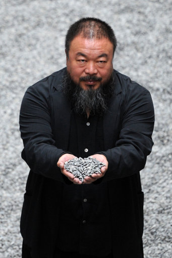 Chinese artist Ai Weiwei with his work 'Sunflower Seeds', the latest commission in the Unilever Series at the Tate Modern, central London.