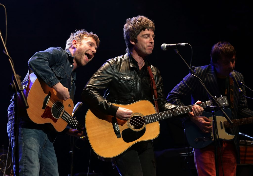 (left to right) Damon Albarn, Noel Gallagher and Graham Coxon performing on stage during their Teenage Cancer Trust gig, at the Royal Albert Hall in London. PRESS ASSOCIATION Photo. Picture date: Saturday March 23, 2013. Photo credit should read: Yui Mok/PA Wire