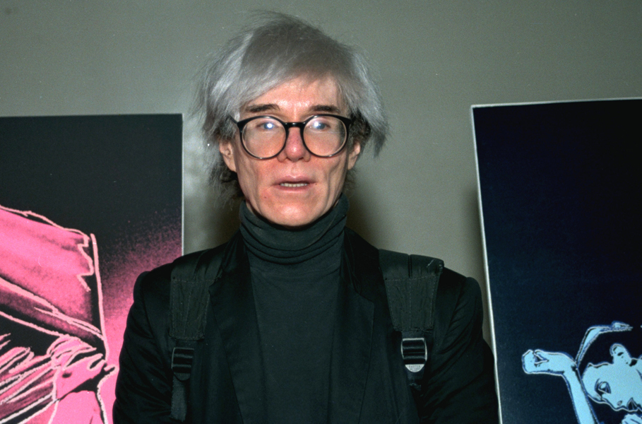 **FILE**Pop artist Andy Warhol is shown in 1987. One of his signature silver wigs and a bracelet that was a gift from Carole Lombard to Clark Gable will be sold at Christie's in a June 22,2006, auction of film and entertainment memorabilia, the auction house said on its Web site.(AP Photo)
