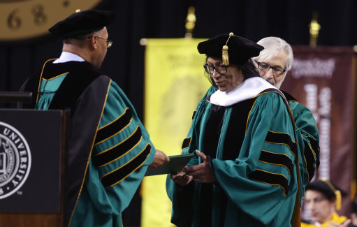 "Wayne State University Board of Governors Vice Chair Gary Pollard, left, presents a Doctor of Humane Letters honorary degree to Sixto Rodriguez, Thursday, May 9, 2013 in Detroit, during the university's commencement. Rodriguez's two albums in the early 1970s received little attention in the United States but he unknowingly developed a cult following in South Africa during the apartheid era. He was the subject of an Oscar-winning documentary, ""Searching for Sugar Man."".(AP Photo/Carlos Osorio)"