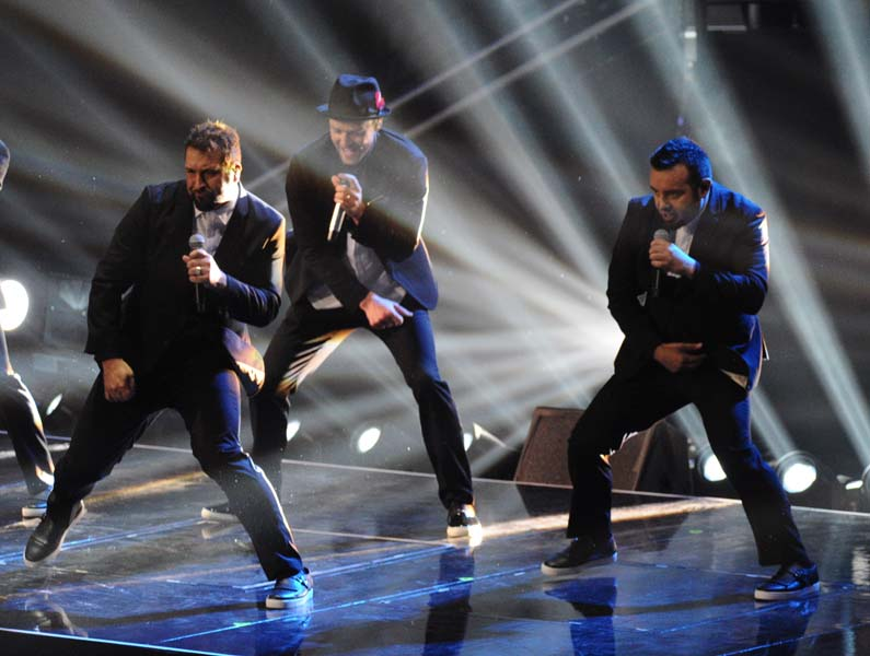Joey Fatone, from left, Justin Timberlake and Chris Kirkpatrick of 'N Sync perform at the MTV Video Music Awards on Sunday, Aug. 25, 2013, at the Barclays Center in the Brooklyn borough of New York. (Photo by Charles Sykes/Invision/AP)