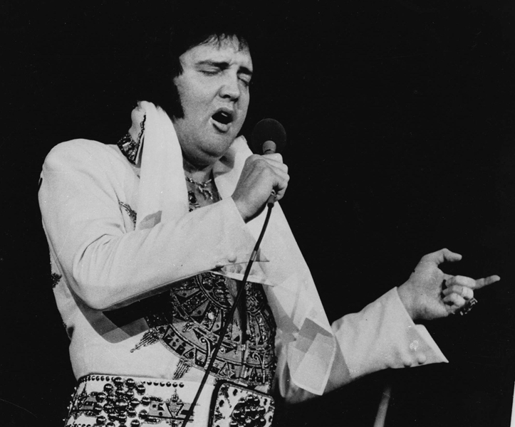 **FOR USE AS DESIRED IN CONNECTION WITH THE 30TH ANNIVERSARY OF ELVIS' DEATH--FILE**Elvis Presley is shown performing in Providence, R.I. on May 23, 1977, three months before his death. (AP Photo)