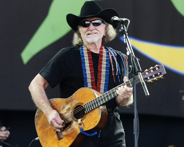 U.S country singer- songwriter Willie Nelson performs on the main stage at Glastonbury Festival, in Glastonbury, England, Friday, June 25, 2010. The Festival celebrates its 40th anniversary this year. (AP Photo/Jim Ross)