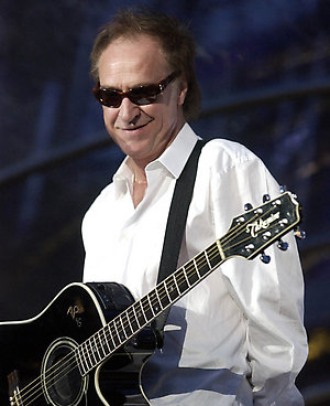 Ray Davies from the Kinks performing on stage with Bon Jovi in London's Hyde Park, on the last day of their Bounce World Tour.  17/03/2004: The Sixties star was Wednesday March 17, 2004 due to collect a CBE for services to music from the Queen. He was awarded the CBE in the New Yeard Honours List.