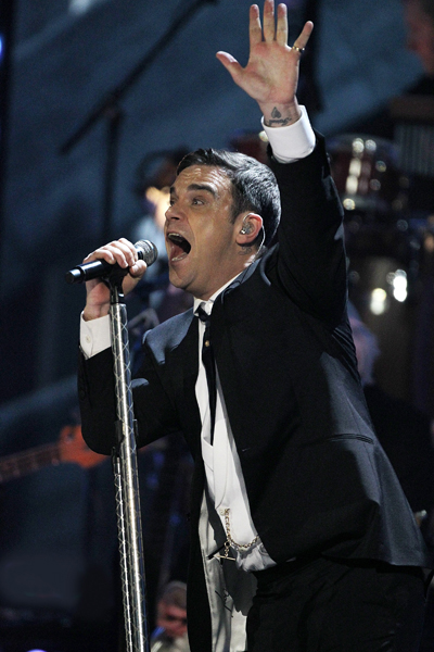 Robbie Williams performs on stage at the Brit Awards, February 16, 2010.