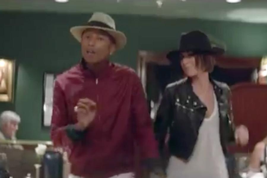 d55939348589c Pharrell is dancing around a restaurant. His friend has an asymmetrical  fringe
