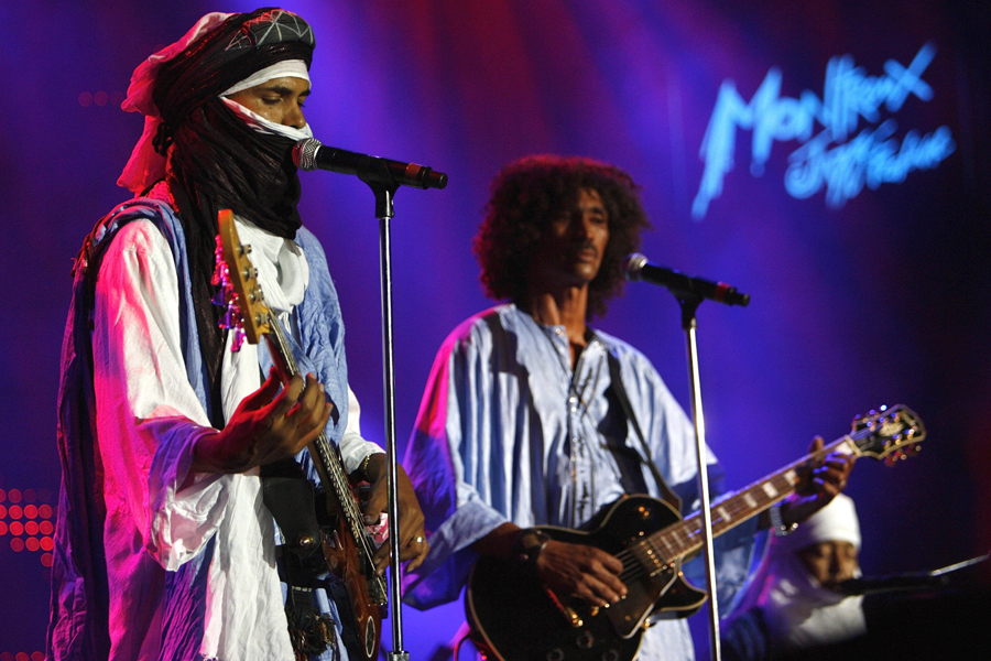 Members of Tuareg band Tinariwen from Mali perform on the Stravinski stage, during the 40th Montreux Jazz Festival, in Montreux, Switzerland, Monday, July 10, 2006. The festival will last until July 15. (AP Photo/KEYSTONE/Laurent Gillieron)