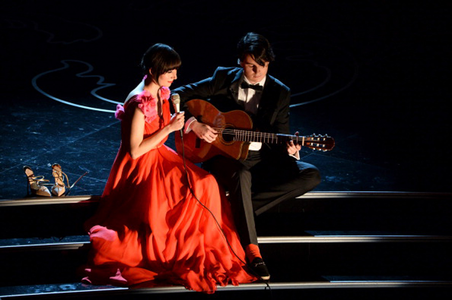 HOLLYWOOD, CA - MARCH 02:  Singer Karen O and musician Ezra Koenig perform onstage during the Oscars at the Dolby Theatre on March 2, 2014 in Hollywood, California.  (Photo by Kevin Winter/Getty Images)