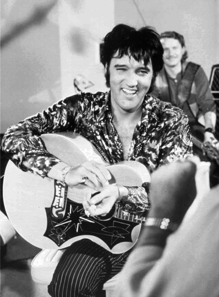 ADVANCE FOR WEEKEND, AUG. 12-13-FILE--Elvis Presley is shown in this 1970 file photo, dateline unknown. To ensure Elvis fans and the general public don't forget the jumpsuit years, the Presley estate is re-releasing the 1970 concert film ``Elvis, That's The Way It is,'' with new concert footage. The 97-minute documentary on Presley's Las Vegas concerts will debut Saturday, Aug. 12, 2000, in Memphis, Tenn., as part of Elvis Tribute Week, the annual fan pilgrimage to the King's hometown to commemorate the anniversary of his death, Aug. 16, 1977. (AP Photo/Permission by Elvis Presley Enterprises)