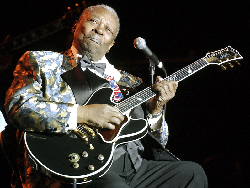 **FILE** Blues guitarist B.B. King performs at the Lowell Memorial Auditorium, Jan. 5, 2005, in Lowell, Mass. King was named entertainer of the year for the seventh time in a row at the 26th annual W.C. Handy Awards in Memphis, Tenn., Thursday night, May 5, 2005.(AP Photo/Lisa Poole)