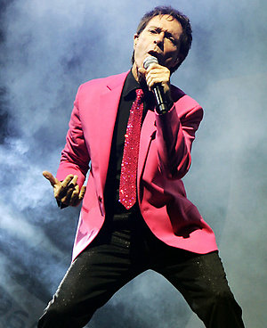 Sir Cliff Richard performing live in concert at Wembley Arena, north London.