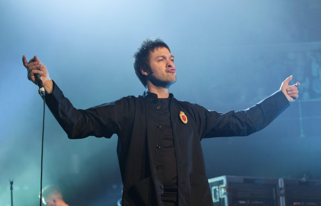 Tom Meighan of Kasabian performing on stage during their Teenage Cancer Trust gig, at the Royal Albert Hall in London. PRESS ASSOCIATION Photo. Picture date: Friday March 22, 2013. Photo credit should read: Yui Mok/PA Wire