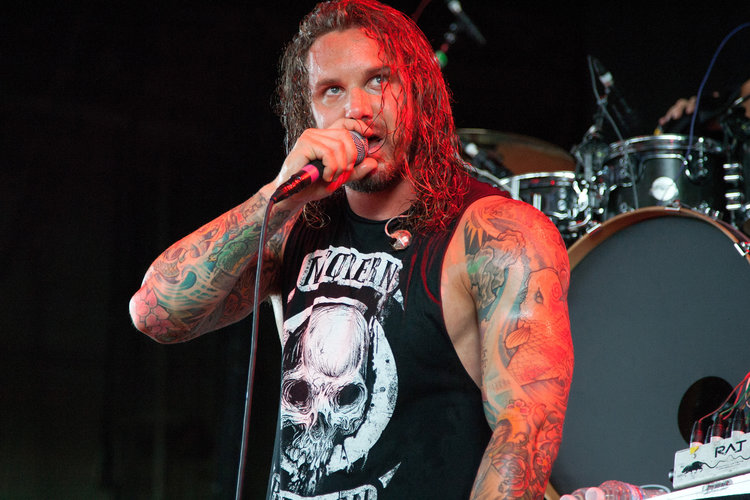 CINCINNATI, OH - JULY 24:  Lead vocalist Tim Lambesis of As I Lay Dying performs during the 2012 Rockstar Energy Drink Mayhem Festival at the Riverbend Music Center on July 24, 2012 in Cincinnati, Ohio.  (Photo by Joey Foley/Getty Images)