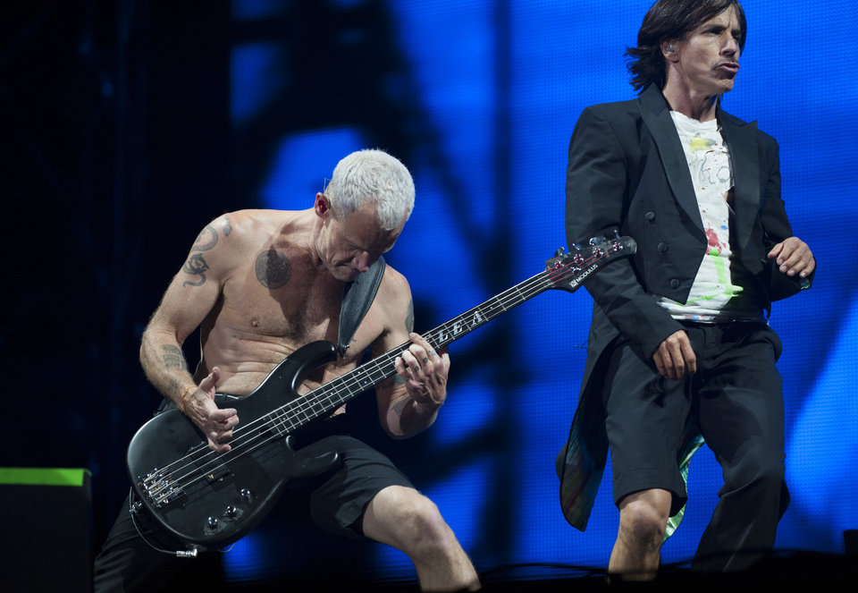 NEWPORT, UNITED KINGDOM - JUNE 14: Flea and Anthony Kiedis of the Red Hot Chili Peppers performs at The Isle of Wight Festival as Seaclose Park on June 14, 2014 in Newport, Isle of Wight. (Photo by Mark Holloway/Redferns via Getty Images)