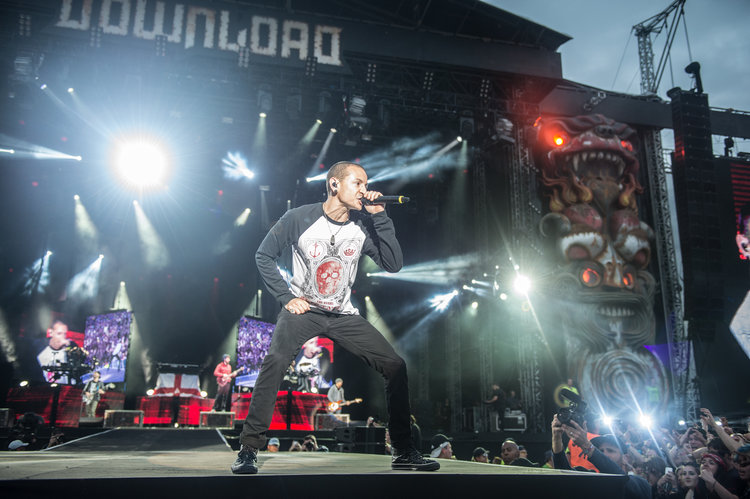 CASTLE DONINGTON, UNITED KINGDOM - JUNE 14: Chester Bennington of Linkin Park performs on Day 2 of the Download Festival at Donington Park on June 14, 2014 in Castle Donington, England. (Photo by Ollie Millington/WireImage)