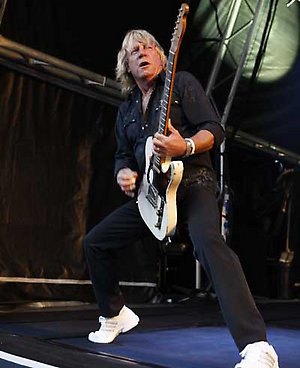 Status Quo perform live in concert at Cannock Chase, Staffordshire.