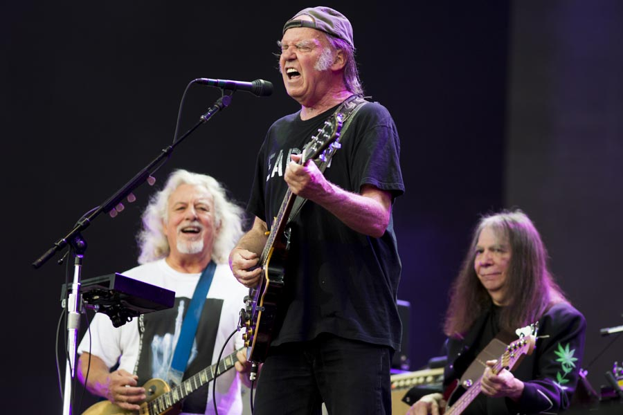 LONDON, ENGLAND - JULY 12:  Neil Young and Frank Sampedro (L) of Crazy Horse perform on stage at British Summer Time Festival at Hyde Park on July 12, 2014 in London, United Kingdom.  (Photo by Tristan Fewings/Getty Images)