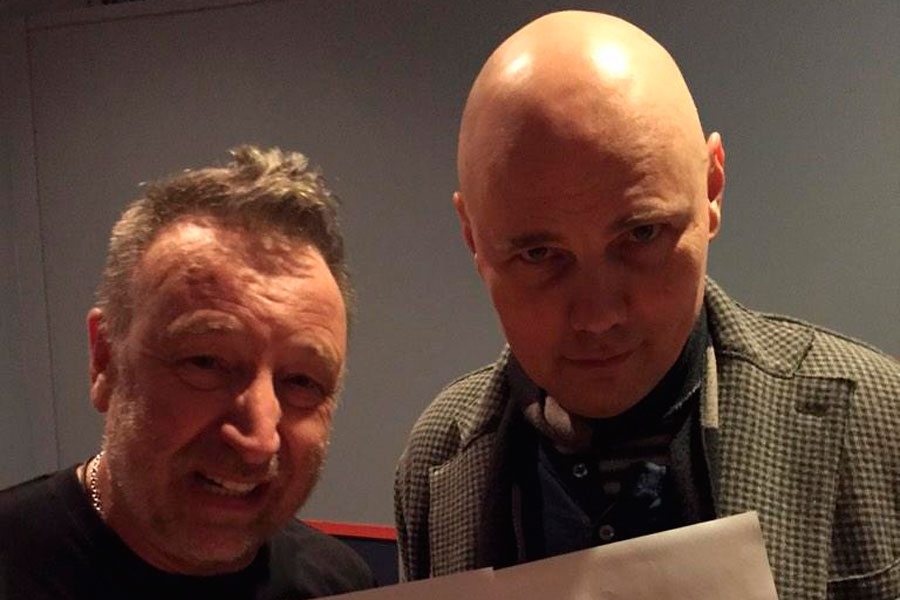 Billy Corgan and Peter Hook perform 'Love Will Tear Us Apart' – watch
