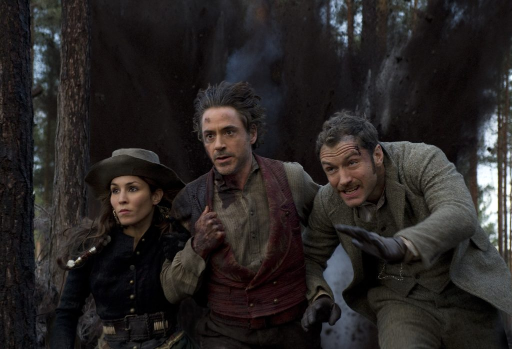 NOOMI RAPACE as Sim, ROBERT DOWNEY JR. as Sherlock Holmes and JUDE LAW as Dr. Watson in Warner Bros. PicturesÕ and Village Roadshow PicturesÕ action adventure mystery ÒSHERLOCK HOLMES: A GAME OF SHADOWS,Ó a Warner Bros. Pictures release.Photo by Daniel Smith