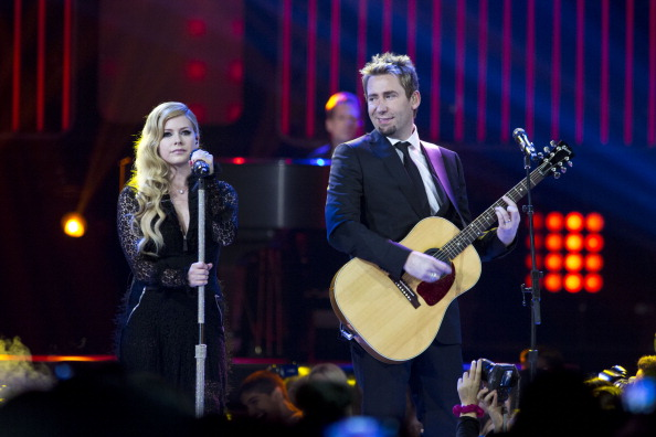 VANCOUVER, BC - OCTOBER 18:  Grammy Award nominated and winning couple Avril Lavigne and Chad Kroeger perform at We Day Vancouver at Rogers Arena on October 18, 2013 in Vancouver, Canada.  (Photo by Phillip Chin/WireImage)
