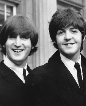 FILE This Oct 26 1965 File Photo Shows John Lennon Left And Paul McCartney As They Smile During A Ceremony At Buckingham Palace In London