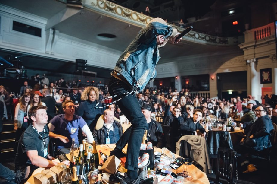 5b24801fc011c Bring Me The Horizon s Oli Sykes jumps on Coldplay s table at NME Awards  2016 with Austin
