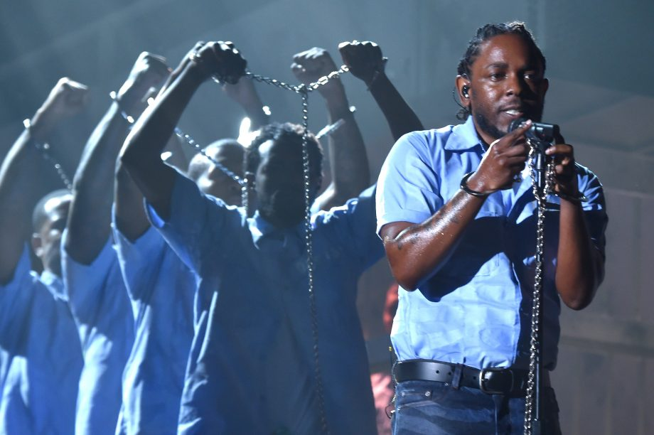 Kendrick Lamar performs whilst shackled in chains at Grammys – watch