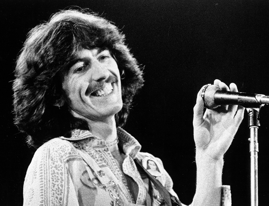 DALY CITY, CA - NOVEMBER 7, 1974:  Singer George Harrison performs at the Cow Palace in Daly City, California, November 7, 1974.  (Photo by Alvan Meyerowitz/Michael Ochs Archives/Getty Images)