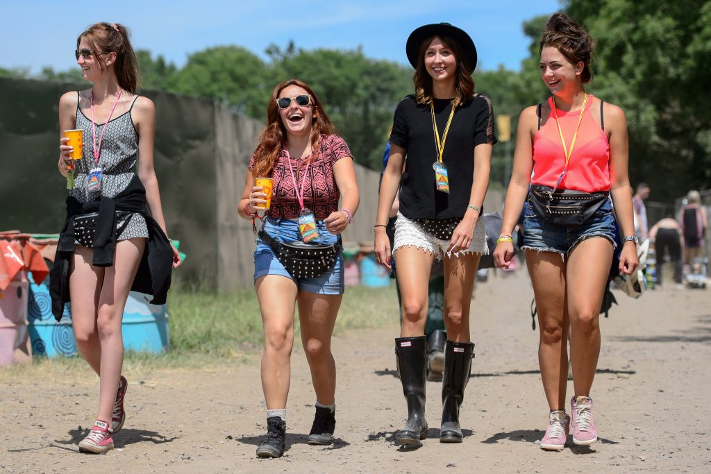 Festival goers arrive with their tents and drink supplies as the gates open at the Glastonbury Festival of Music and Performing Arts in Somerset, south west England, on June 25, 2014.  AFP PHOTO / LEON NEAL        (Photo credit should read LEON NEAL/AFP/Getty Images)