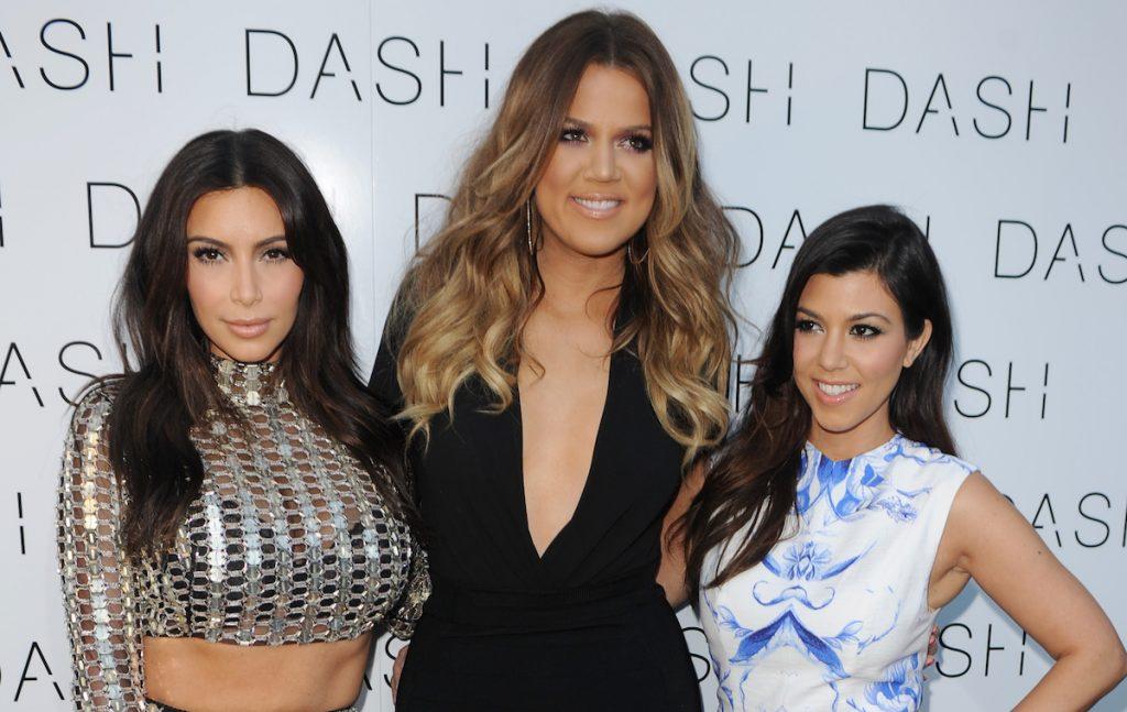 MIAMI BEACH, FL - MARCH 12: Kim Kardashian, Khloe Kardashian and Kourtney Kardashian attend the Grand Opening of DASH Miami Beach at Dash Miami Beach on March 12, 2014 in Miami Beach, Florida. (Photo by Larry Marano/WireImage)