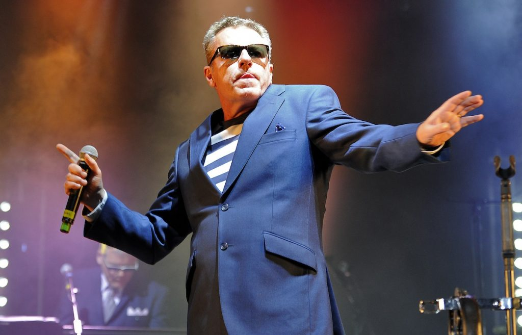 CANTERBURY, ENGLAND - SEPTEMBER 11:  Graham McPherson aka 'Suggs' performs on stage with Madness at The Spitfire Ground on September 11, 2015 in Canterbury, England.  (Photo by Matt Kent/WireImage)