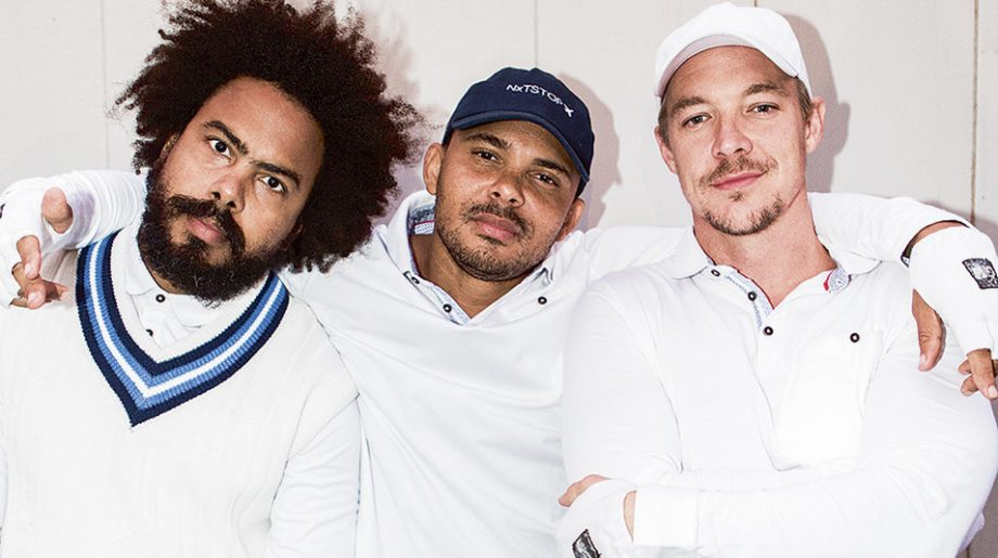 Musicians Major Lazer posing for photo.