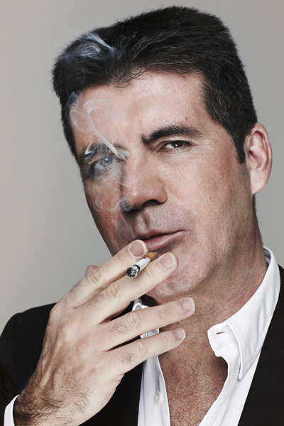 Simon Cowell Appeared To Be Flashing His Penis While On