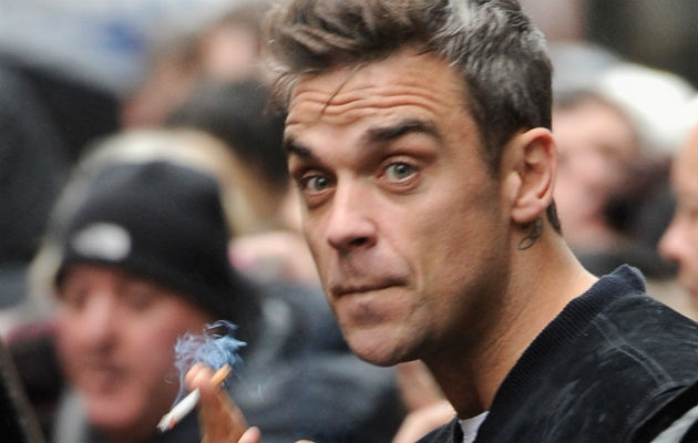 Robbie Williams Says He Smoked A Spliff At Buckingham