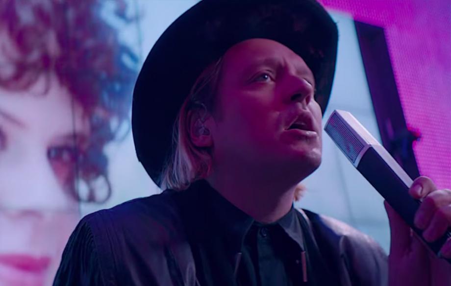 Watch Arcade Fire plot a heist in epic 'Money + Love' double video - NME