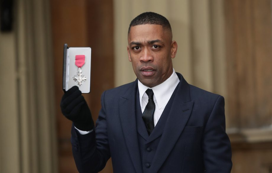 wiley braved the freezing cold to pick up his mbe at buckingham palace