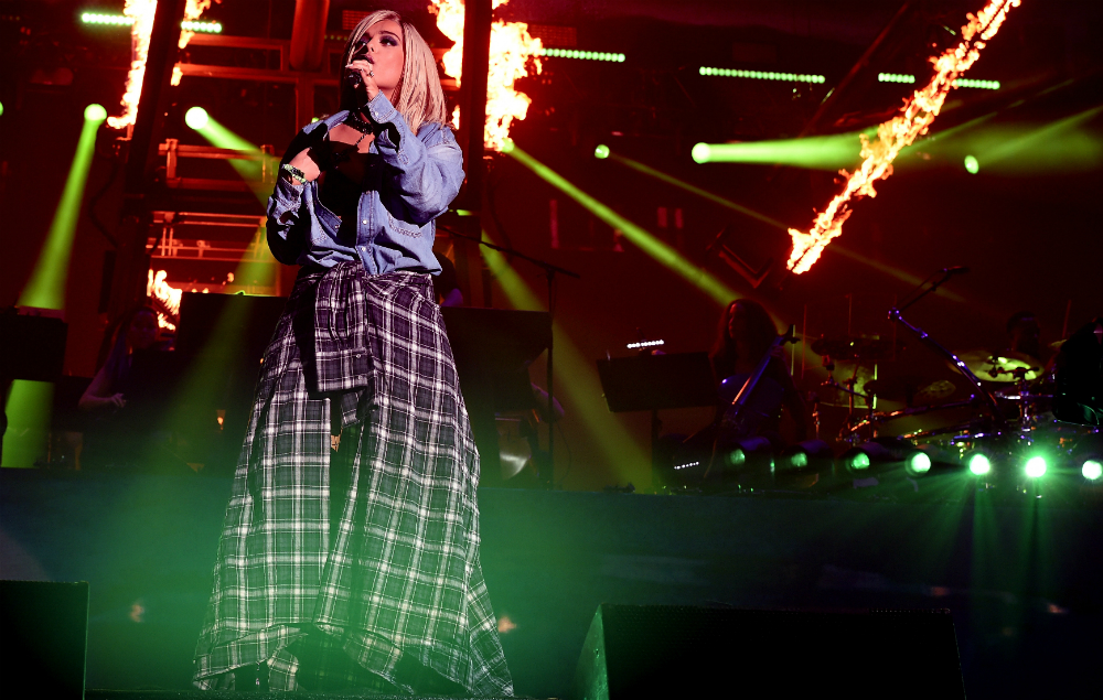 Bebe Rexha performs onstage with Eminem during the 2018 Coachella Valley Music and Arts Festival Weekend 1 at the Empire Polo Field on April 15, 2018 in Indio, California.