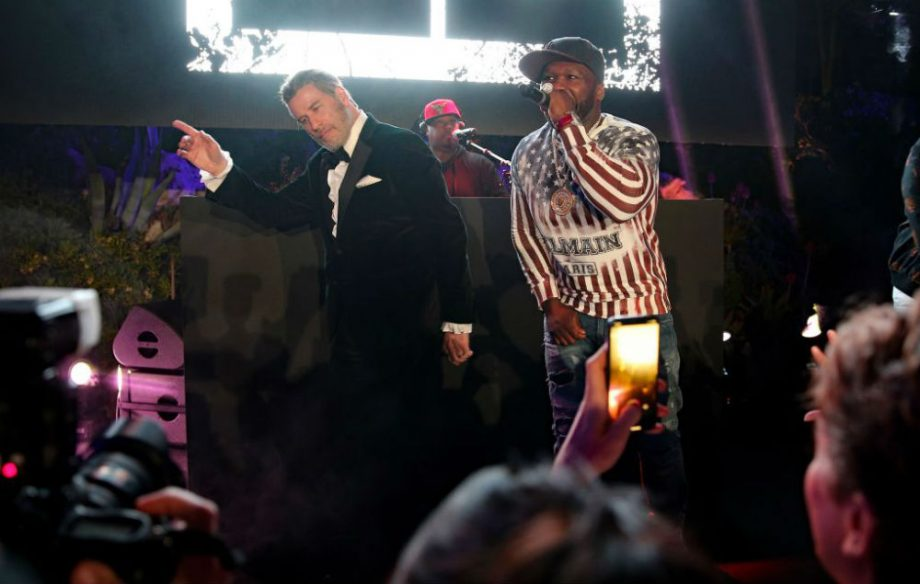 Watch John Travolta dance with 50 Cent at Cannes - NME