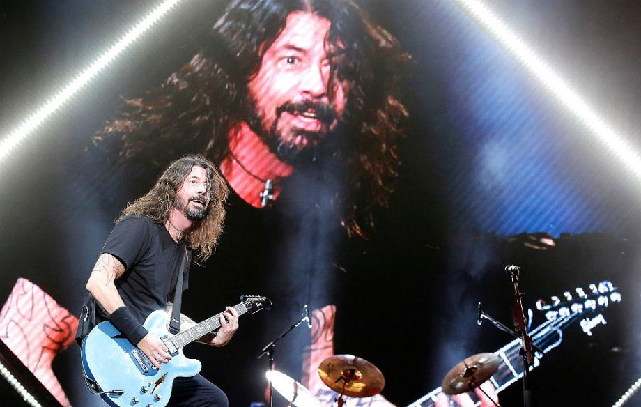 """""""I am Simon Cowell"""" – watch Dave Grohl test 'repeat offender' fan's skills on stage"""